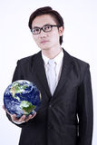 Businessman hold globe - isolated Stock Images