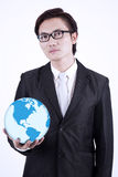 Businessman hold globe on white background Stock Image