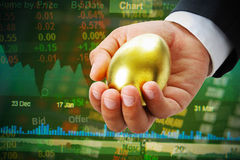 Businessman hold golden egg Stock Photography