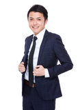 Businessman hold with his collar Royalty Free Stock Photography