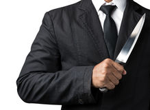 Businessman hold on knife Stock Image