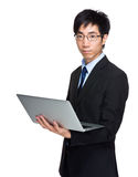 Businessman hold with laptop computer Royalty Free Stock Photography