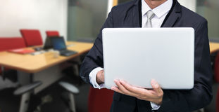 Businessman hold laptop computer Royalty Free Stock Image
