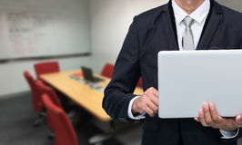 Businessman hold laptop computer Stock Photography