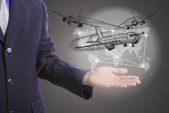 Businessman hold logistic business world. With airplane concept Stock Photo