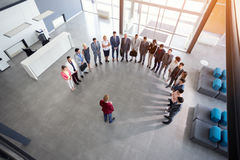 Businessman hold meeting with employees stock images