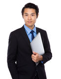 Businessman hold with notebook computer Royalty Free Stock Photo