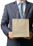 Businessman hold paper bag with both hand,business concept Royalty Free Stock Image