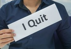 Businessman hold paper sheet of I quit as resignation letter from the office royalty free stock photos