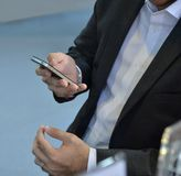 Businessman hold a phone Stock Image