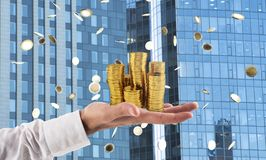 Businessman hold piles of money. Concept of success and company growth. Businessman hold piles of gold money Concept of success and company growth royalty free stock photography