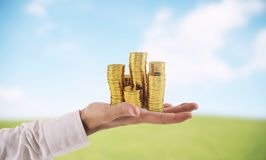 Businessman hold piles of money. Concept of success and company growth. Businessman hold piles of gold money Concept of success and company growth royalty free stock photo