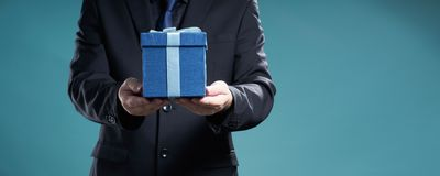 Businessman hold the present box royalty free stock photos