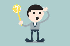 Businessman hold question mark plate Stock Photos