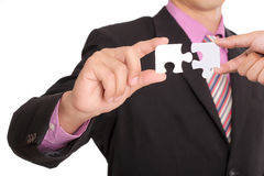 Businessman hold red puzzle piece for good success business Royalty Free Stock Image