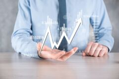 Businessman hold sales data and economic growth graph chart. Business planning and strategy. Analysing trading of exchange.