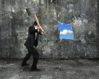 Businessman hold sledgehammer cracking big hole discovered natur Stock Image