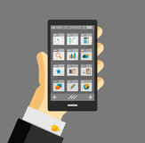 Businessman hold smartphone with apps Stock Images