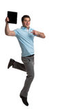Businessman Hold Touch Pad Jumping Stock Photography