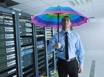Businessman hold umbrella in server room Royalty Free Stock Photos