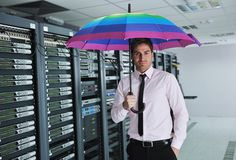 Businessman hold umbrella in server room Stock Image
