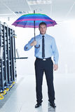 Businessman hold umbrella in server room Royalty Free Stock Photo