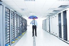 Businessman hold umbrella in server room Royalty Free Stock Images