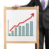 Businessman hold wooden white board with flourish market trend a. Nd histogram drawing in white background Stock Images