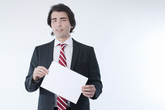 Businessman holdind an empty advert Stock Image