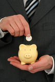 Businessman Holding A Piggy Bank Stock Photo