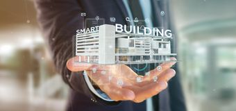Free Businessman Holding A Smart Building Connected - 3d Rendering Royalty Free Stock Photo - 168282355