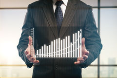 Businessman holding abstract business chart Royalty Free Stock Image