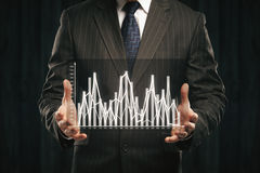 Businessman holding abstract business graph Royalty Free Stock Photo