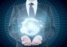 Businessman holding abstract illuminated globe Stock Image