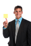 Businessman Holding Adhesive Note Stock Photo