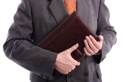 Businessman holding agenda Royalty Free Stock Photo