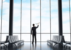 Businessman holding airplane Royalty Free Stock Image