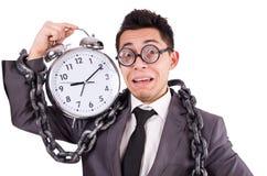 Businessman holding alarm clock isolated on white. The businessman holding alarm clock isolated on white Royalty Free Stock Photography