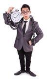 Businessman holding alarm clock isolated on white Stock Images