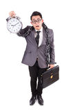 Businessman holding alarm clock isolated on white Royalty Free Stock Photos