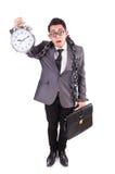Businessman holding alarm clock isolated on white. The businessman holding alarm clock isolated on white Royalty Free Stock Photos