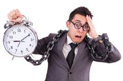 Businessman holding alarm clock isolated on white. The businessman holding alarm clock isolated on white Stock Photography
