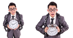 The businessman holding alarm clock isolated on white Royalty Free Stock Images