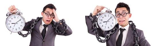 The businessman holding alarm clock isolated on white Royalty Free Stock Photo