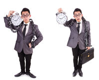 The businessman holding alarm clock isolated on white Royalty Free Stock Photography