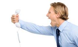 Businessman holding analogue phone isolated  on white background Royalty Free Stock Photos