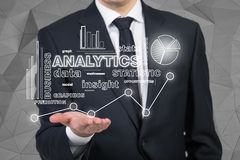 Businessman holding analytics Stock Photography