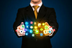 Businessman holding app icon cloud Royalty Free Stock Images