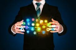Businessman holding app icon cloud Stock Photo