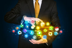 Businessman holding app icon cloud Royalty Free Stock Photo